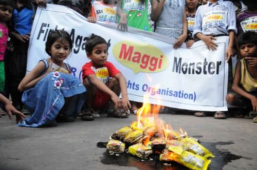 People burn Maggi packets in Kolkata on June 4, 2015. Maggi has been banned in several states after samples of the noodles were found to contain more than the permissible quantity of lead. (Photo: IANS)