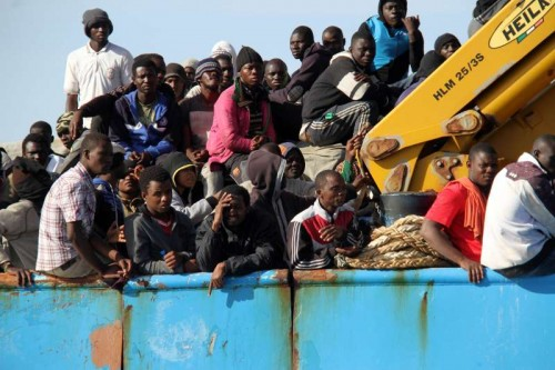 A Libyan coastguard boat carrying mostly African illegal migrants arrives at the port in the city of Misrata, Libya, on May 3, 2015, after the coastguard intercepted five boats carrying around 500 people trying to reach Europe.