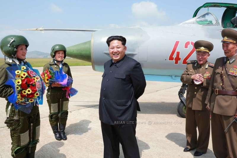 Photo provided by Korean Central News Agency (KCNA) shows top leader of the Democratic People's Republic of Korea (DPRK) Kim Jong Un (C) watching a flight training of women supersonic fighter pilots recently.