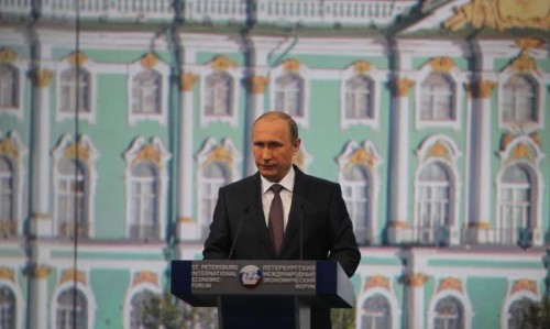 Russian President Vladimir Putin addresses a plenary session of the 19th St. Petersburg International Economic Forum in St. Petersburg, Russia, on June 19, 2015.