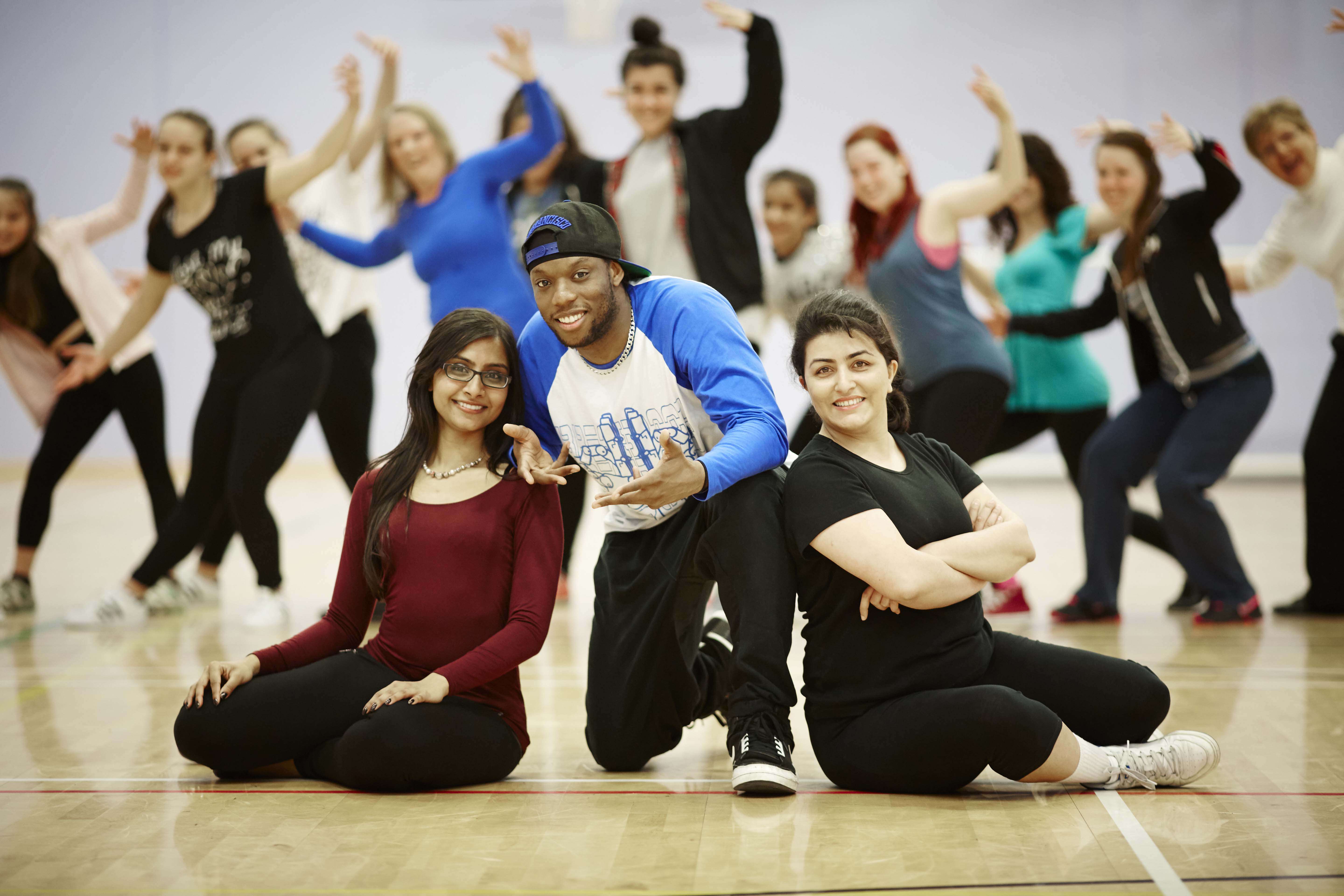 Chandni Patel (24) and Solmaz Rohani (33) from Salford with hip hop artist Syxx Issac from Blue Boy Entertainment at the taster session  at the Oasis Academy in Salford