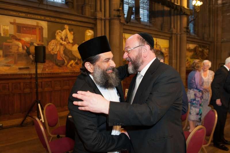 MJF Chief Rabbi and Ibrahim Mogra embracing