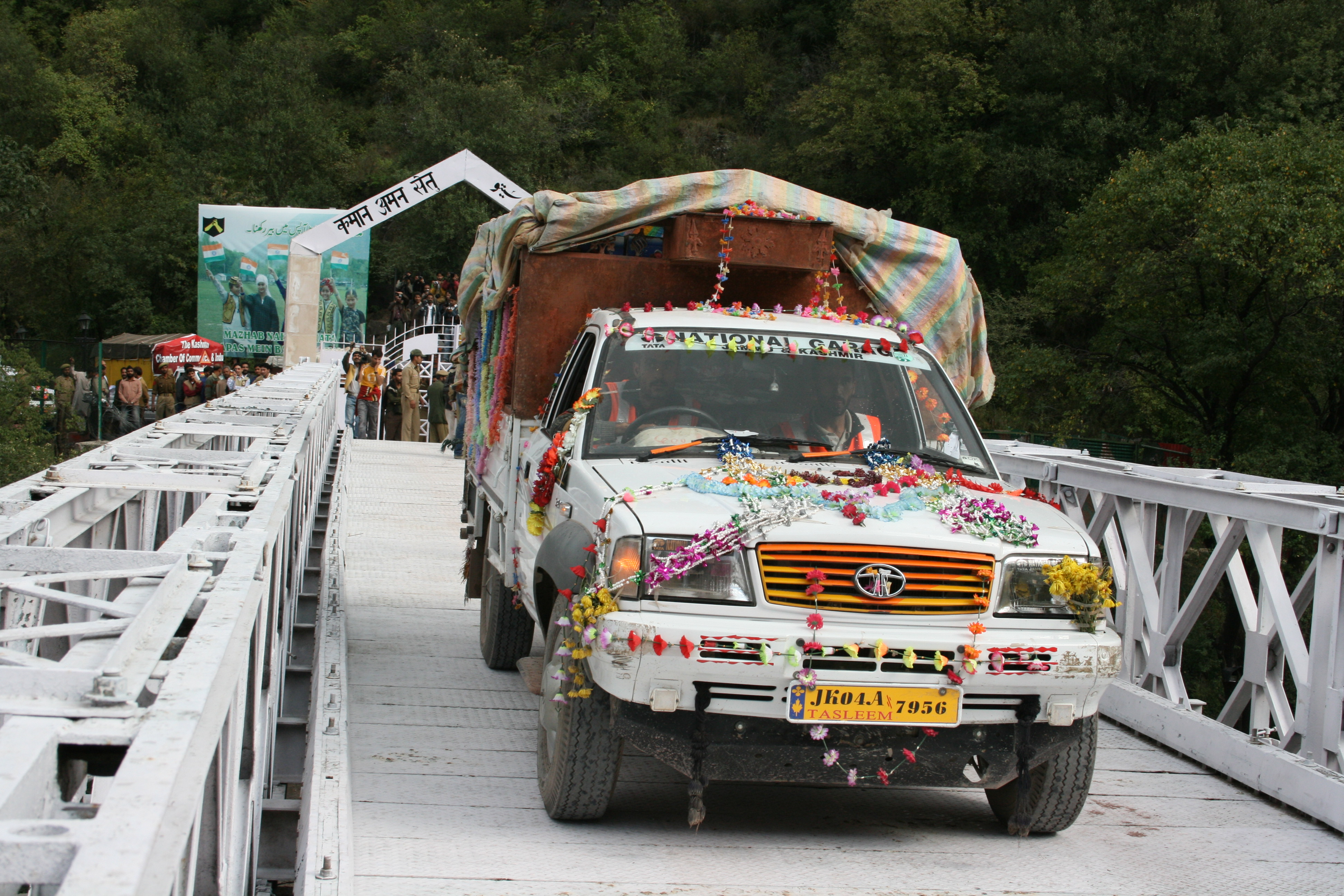 First truck carrying goods for trade crossing Aman Setu (peace bridge) at Chakoti in October 2008 at the Line of Control fromJammu and Kashmir (Indian side) to Azad Jammu and Kashmir (Pakistani side).