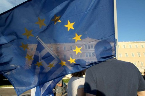 "Demonstrators rally in front of the Greek Parliament to support Greece's place in the Eurozone, in Athens, Greece, June 18, 2015. As the potential exit of Greece from the Eurozone monetary union is hanging over negotiations with Greek international creditors, the rally was organized to promote the idea of ""staying in Europe"""