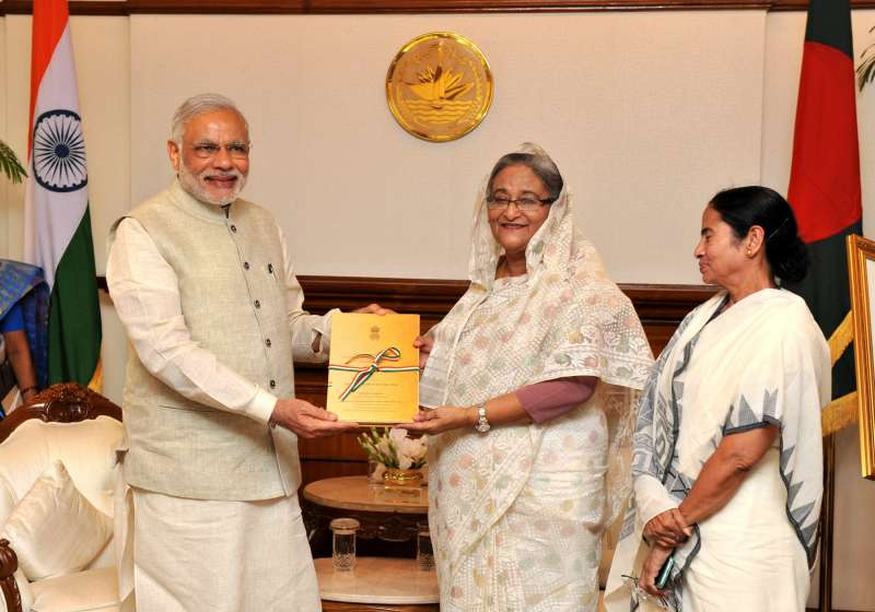 Indian Prime Minister Narendra Modi presents to the Bangladesh Prime Minister Sheikh Hasina, a transcript of Parliamentary debates on LBA, in Dhaka, Bangladesh on June 6, 2015. Also seen Chief Minister of West Bengal, Kumari Mamata Banerjee.
