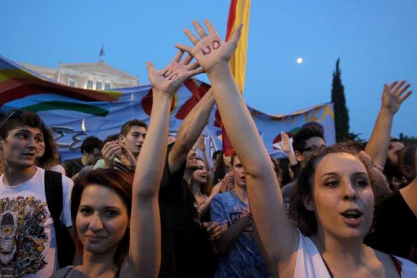 """Thousands of Greeks participate in a rally called by governing Syriza party to protest against austerity measures and urge voters to say """"No"""" in the July 5 referendum on bailout terms in Athens, Greece, on June 29, 2015. Breakdown in negotiations between Athens and its international creditors plunged the country deep into crisis. Greek government announced capital controls until July 6, while banks and Athens Stock Exchange remain shut."""