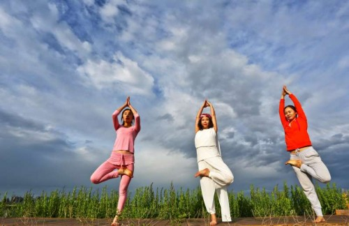 People practice yoga at Zhangye wetland reserve in Zhangye, northwest China's Gansu Province, June 7, 2015.