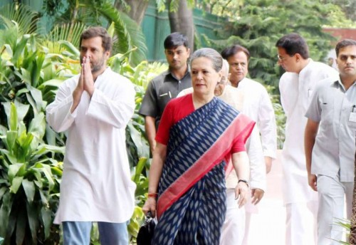 Congress president Sonia Gandhi and vice president Rahul Gandhi arrive to attend a party meeting in New Delhi, on June 9, 2015.