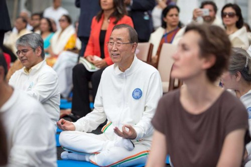 Ban Ki-moon, Secretary General of United Nations, joins hundreds in performing Yoga at the UN headquarters, New York, the United States, on the first International day of Yoga, June 21, 2015.