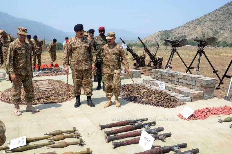 Pakistani Army Chief General Raheel Sharif (C) looking at huge cache of weapons and ammunition recovered from terrorists during his visit to northwest Pakistan's Khyber Agency. At least 20 militants were killed and 18 others injured in an air-raid by Pakistani army in the country's northwestern tribal area of Khyber Agency