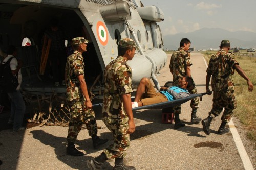 Soldiers take away an injured for treatment in earthquake hit Nepal on May 31, 2015
