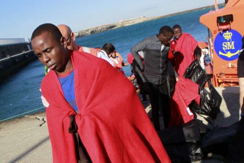 One of the 10 sub-Saharan migrants who were rescued by the Spanish Maritime Rescue Services receives medical care upon their arrival to Tarifa's port in the province of Cadiz, southern Spain, 18 June 2015. The migrants were rescued from a toy boat when they were trying to cross the Strait of Gibraltar to reach the Spanish southern coasts