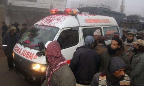 An ambulance, carrying the body of an executed prisoner and pictured with rose petals
