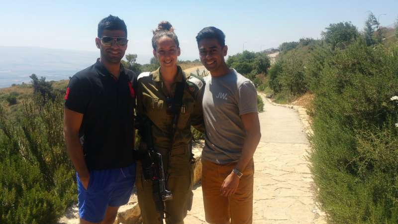 Pranav Bhanot and Ameet Jogia with a member of israeli Defence Force