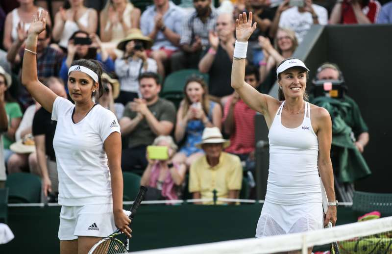 Martina Hingis  of Switzerland and Sania Mirza of India greet the audience