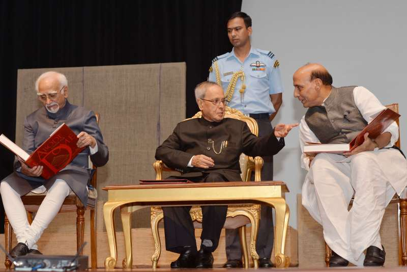 President Pranab Mukherjee, the Vice President Mohd. Hamid Ansari and the Union Home Minister Rajnath Singh during the release of the book titled ``Abode under the Dome``, at Rashtrapati Bhavan, in New Delhi