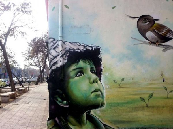 Image taken with a mobile phone, shows a mural painted on a wall of a building in Santiago city, capital of Chile. Urban art is a form of visual art created on public places as a way of expression of the artists.