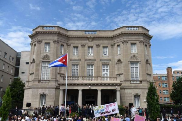 People watch the opening ceremony of Cuba's embassy as the national flag of Cuba is being raised in Washington DC, the United States, July 20, 2015.