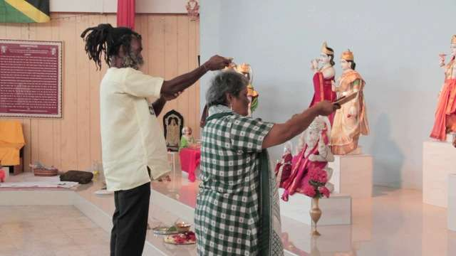A still from the Dreadlock Story documentary by Linda Ainouche. Rasta in Hindu Temple