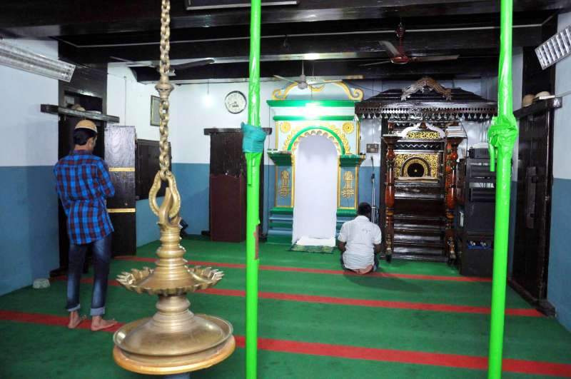 KODUNGALLUR MOSQUE: The sanctum sanctorum with a traditional Kerala-style lamp, and a mimber, or the pulpit, from where the Imam delivers sermons, that has intricate carvings and lacquer work, unique to southern India