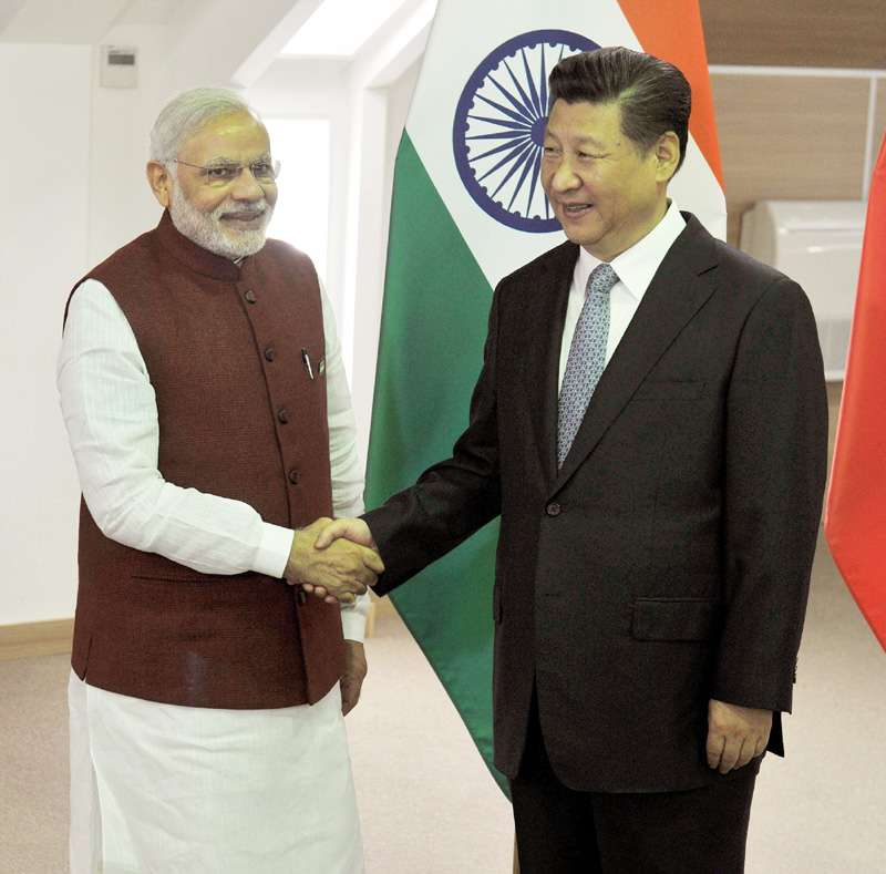 Prime Minister Narendra Modi with President of the People's Republic of China, Mr. Xi Jinping, in Ufa, Russia a