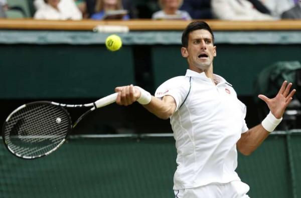 Novak Djokovic of Serbia returns a ball during men's singles final against Roger Federer of Switzerland at the 2015 Wimbledon Championships in Wimbledon, southwest London, July 12, 2015.