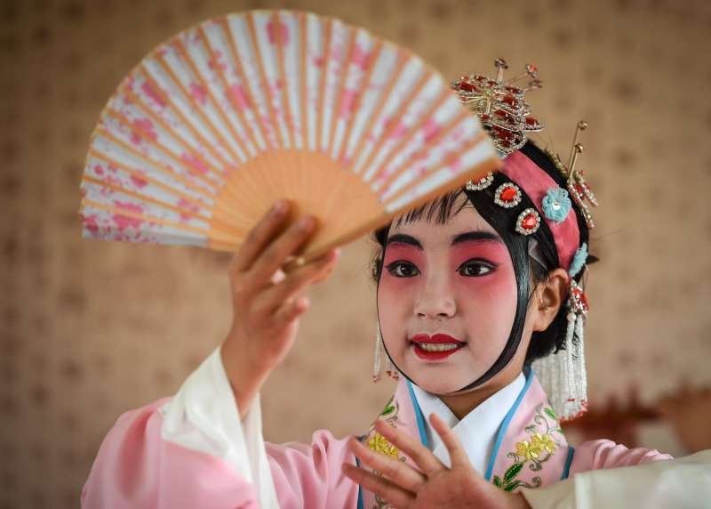 A Chines dancer performing a traditional dance