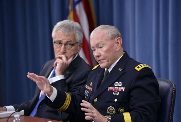 US Secretary of Defense Chuck Hagel (L) and Chairman of the Joint Chiefs of Staff General Martin Dempsey hold a press briefing at the Pentagon in Washingto