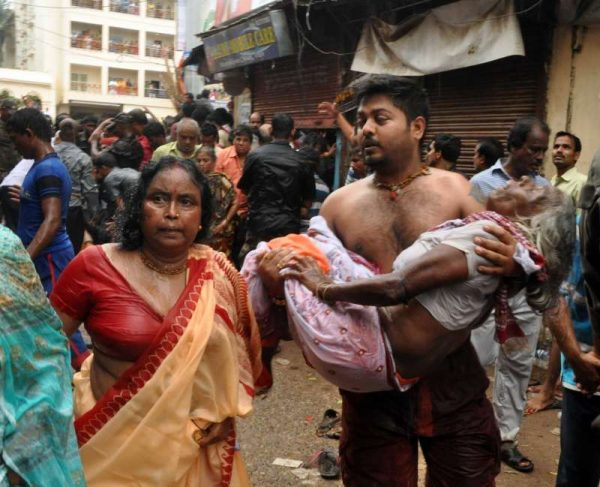 A devotee being taken away for treatment due to stampede that occurred during the pulling of Balabhadra ratha chariots in `Nabakalebar Rath Yatra` in Puri on July 18, 2015
