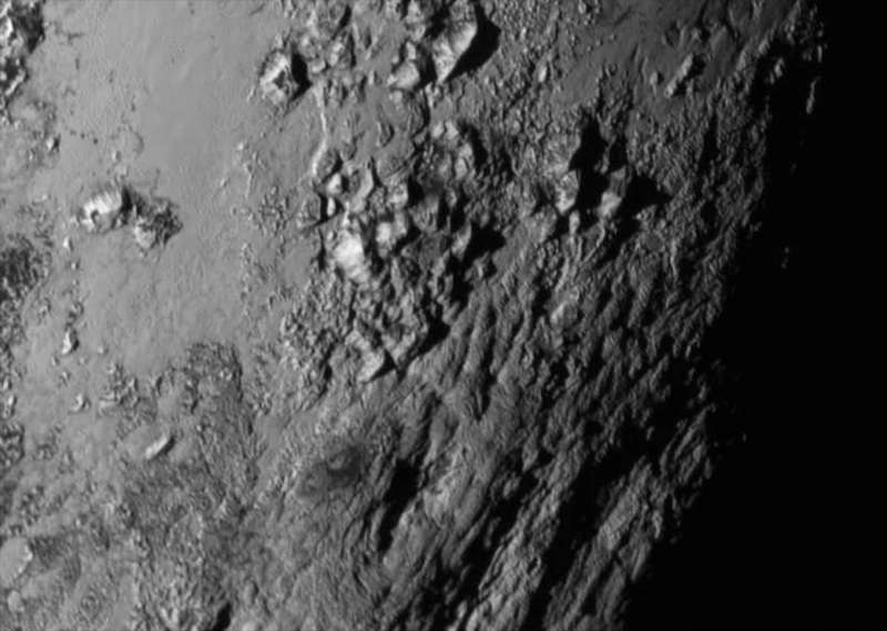 New close-up images of a region near Pluto's equator reveal a giant surprise: a range of youthful mountains