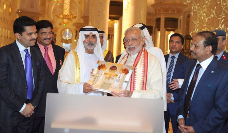 Prime Minister Narendra Modi receives a gift during the visit