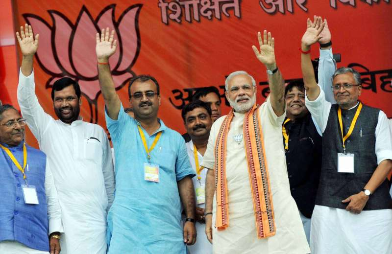 Prime Minister Narendra Modi during the `Parivartan rally` in Saharsa, Bihar, on Aug 18, 2015. Also seen Union Minister for Consumer Affairs, Food and Public Distribution Ramvilas Paswan, BJP leaders Mangal Pandey and Sushil Kumar Modi