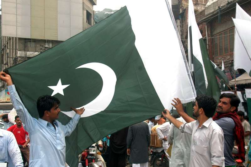 Pakistanis in Lahore preparing to celebrate Independence Day on Aug 14