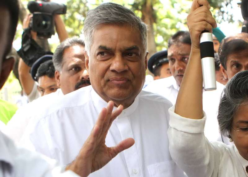 Sri Lankan Prime Minister and candidate of the ruling United National Party (UNP) Ranil Wickremesinghe (C) arrives at a polling station in Colombo, capital of Sri Lanka, on Aug. 17, 2015. Sri Lankan voters on Monday queued up to cast their votes for a parliamentary election amidst tight security to elect a new 225 member parliament and a new government.