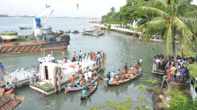 Security personnel carry out rescue operations at the site where two boats collided near Fort Kochi, in Kochi on Aug 26, 2015. Eight people were killed in the accident.