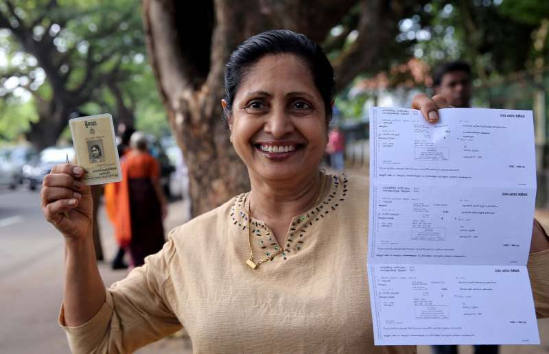 A voter shows her credentials at a polling center in Colombo