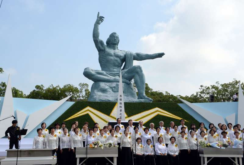A chorus performs during a ceremony commemorating the 70th anniversary of the bombing of Nagasaki, at the Peace Park in Nagasaki, Japan