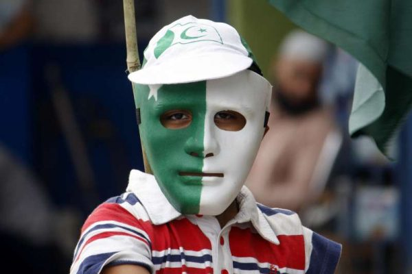 A Pakistani boy wears a mask painted with national flag color for the upcoming independence day celebration at a roadside stall in Lahore, east Pakistan, Aug. 8, 2015. Pakistan will celebrate its 69th anniversary of independence on Aug. 14.