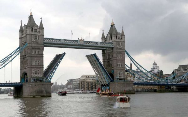 A flotilla of historic vessels, leisure cruisers and passenger boats pass under the Tower Bridge in a procession on the River Thames to mark the day on which Queen Elizabeth II becomes the longest reigning monarch in British history, in London, Britain, on Sept. 9, 2015. Wednesday marks the 63 years and 216 days since the Queen came to the throne. The procession began from east of Tower Bridge at midday, with the vessels sounding their horns for one minute. Also, the Tower Bridge lifted as a sign of respect. (