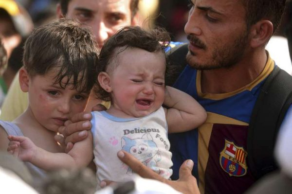 A Syrian refugee family seeking help in Hungary