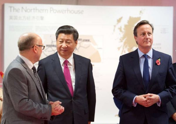 MAG CEO Charlie Cornish with President Xi Jinping and PM David Cameron at Manchester Airport (File)