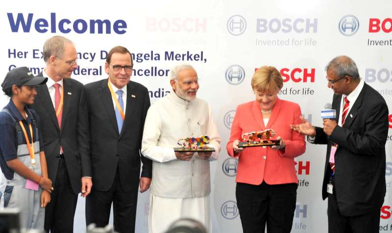 Modi and the German Chancellor, Dr. Angela Merkel being presented the mementos at the Robert Bosch Engineering & Innovation Centre, in Bengaluru