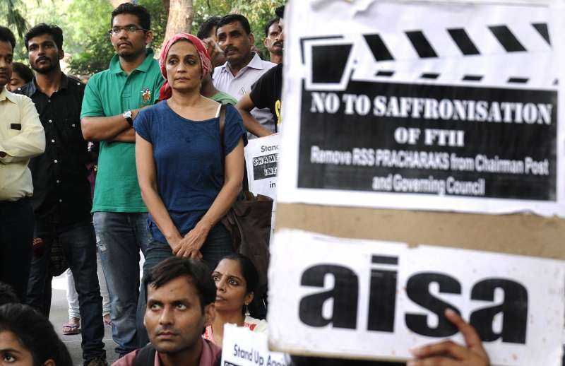 Indian writer Arundhati Roy joins the students from the Film and Television Institute of India (FTII) during a protest against the appointment of Gajendra Chauhan as the chairman of the FTII, in New Delhi