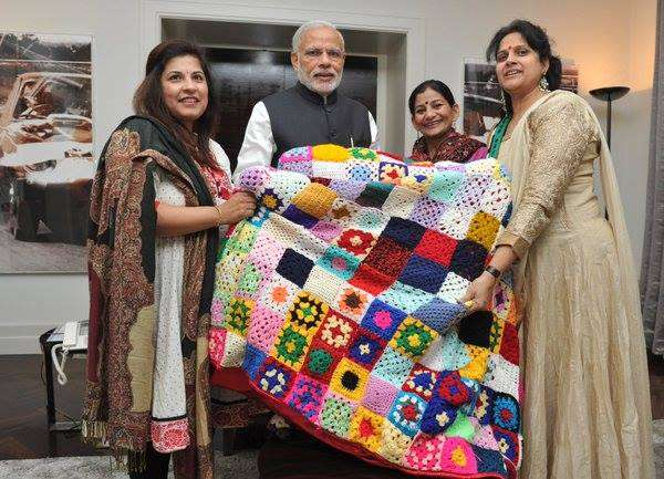 Members of the Indian Ladies in UK (ILU) group presents a unique crocheted blanket to Modi