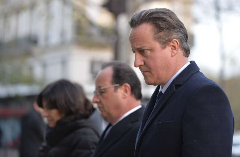 Prime Minister David Cameron  and French President François Hollande paying tributes to the victims of Paris attacks