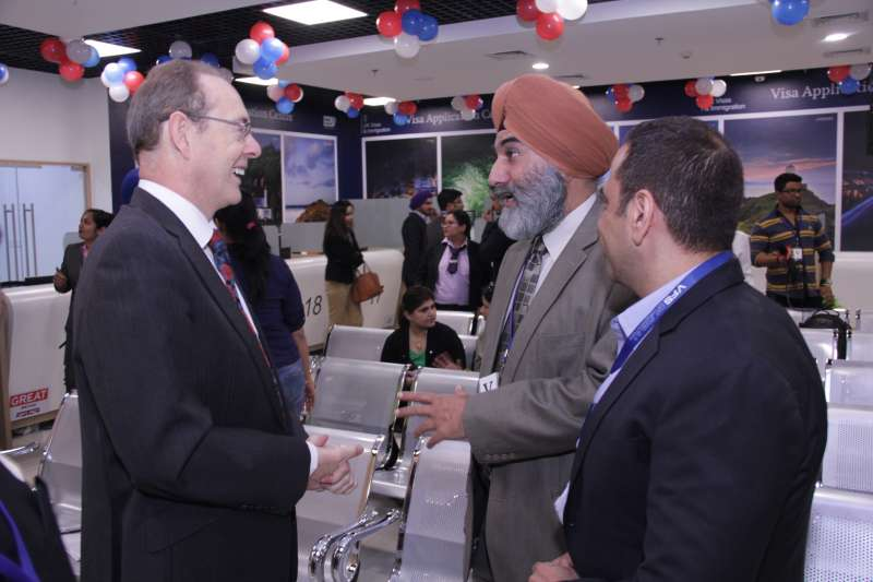 British High Commissioner for India Sir James Bevan interacting with the public during the inauguration of Visa Application Centre (VAC) in Connaught Place in New Delhi