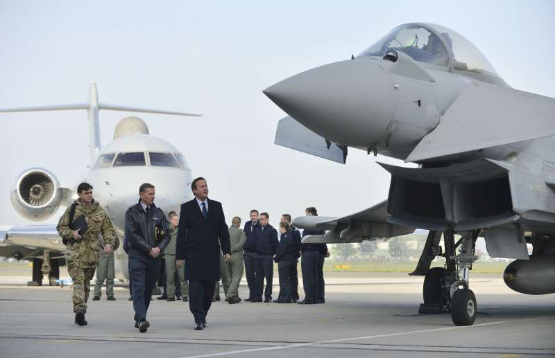 Prime Minister David Cameron looks at Typhoon during visit to RAF Northolt