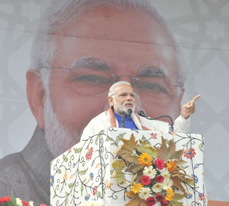 Prime Minister Narendra Modi delivers his address at the public meeting at Sher-e-Kashmir cricket stadium, in Srinagar