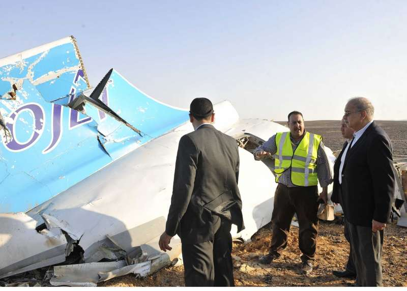 The handout photo from Egyptian Prime Minister Office shows Egyptian Prime Minister Sherif Ismail (R) inspecting the crash site of a Russian passenger plane in Hassana, a mountainous area 35 km south of Arish City, Egypt, Oct. 31, 2015. The black box of the Russian plane that crashed in Egypt's Sinai earlier on Saturday has been found and 129 bodies have been picked up, Egyptian Prime Minister Sherif Ismail said at a press conference