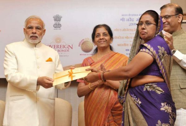 Prime Minister Narendra Modi launches the Gold schemes, in New Delhi on November 05, 2015. The Minister of State for Finance Jayant Sinha and the Minister of State for Commerce and Industry (Independent Charge), Nirmala Sitharaman are also seen.